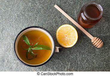 Cannabis herbal tea on stone table
