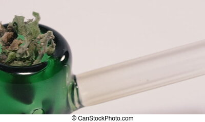 Cannabis. Marijuana weed with smoking pipe.