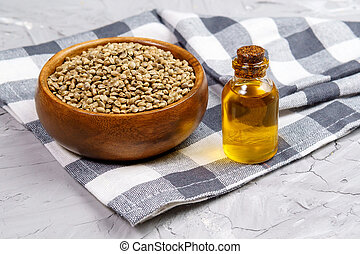 Bottles of hemp oil with cannabis seeds. Medical CBD oil. Alternative medicine concept.