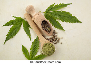 Cannabis seeds and green leaves. Vegetarian healthy food. Healthy lifestyle. Flat lay, top view