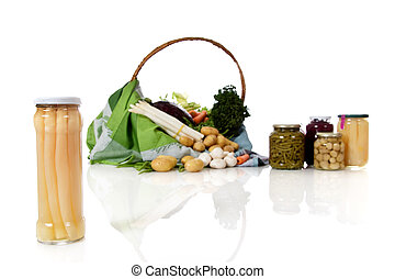 Canned asparagus in a jar, canned and fresh vegetables