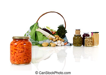 Canned carrots in a jar, canned and fresh vegetables.