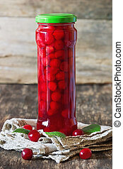 Canned cherries in a glass jar