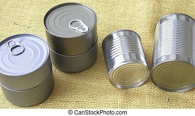 Canned food in cans on the yellow jute
