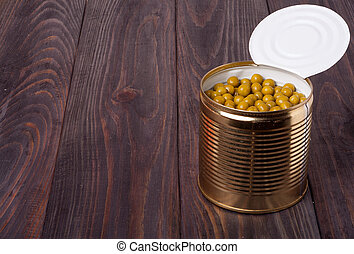 canned green peas in a bank on wooden table