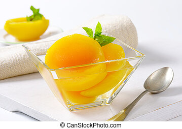 Bowl of peach halves in light syrup