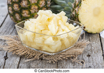 Canned Pineapple on vintage wooden background (close-up...