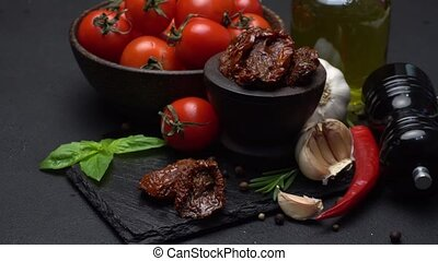 Canned Sundried or dried tomato halves in wooden bowl, dark...