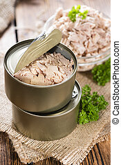 Canned Tuna - Portion of Tuna with fresh parsly on wooden...