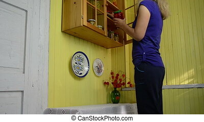 canned vegetable jars - housewife on a small table...