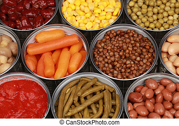 Vegetables such as carrots, lentils, corn, peas and tomatoes in cans