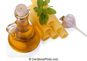 Cannelloni with olive oil in a glass bottle, fresh basil and garlic isolated on white background