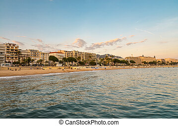 Cannes bay at sunset with beautiful cityscape, french...