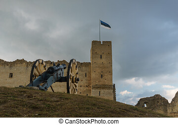 Cannon against medieval castle in Rakvere, Estonia