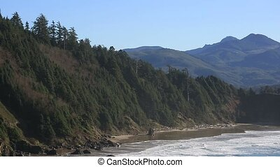 Cannon Beach from Ecola State Park with views of rock formations in Oregon