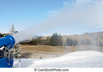 Cannon fires snow on the ski slopes