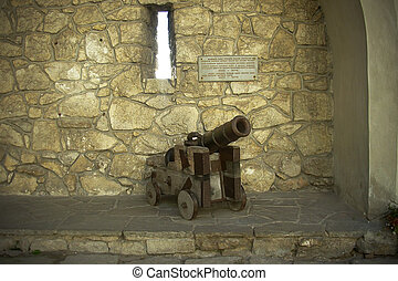cannon in the courtyard of an old castle