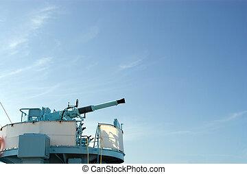 Cannon on blue sky.