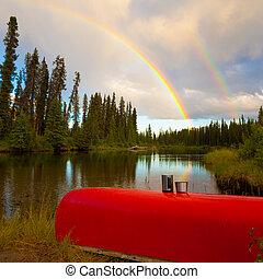 Canoe and Rainbow - Overturned canoe with coffee mugs under ...