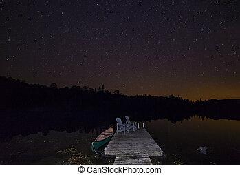 Canoe at dock under a September night sky - Ontario, Canada