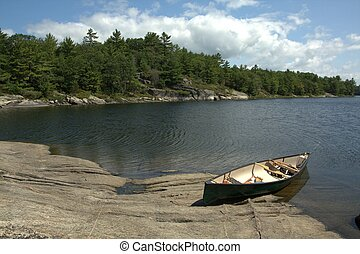 A view of a canoe in the Honey Harbour area of Georgian Bay, on a beautiful sunny day.