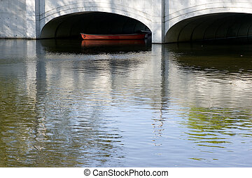 canoe below the bridge