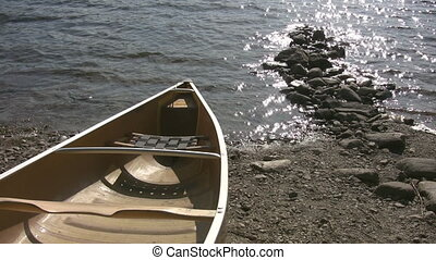 Canoe by lake. - A kevlar canoe sitting by the lake....