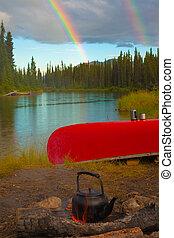 Canoe, Campfire and Rainbow - Overturned canoe and campfire ...