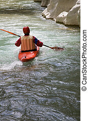 canoe driver on the river in the canyon of Acheron