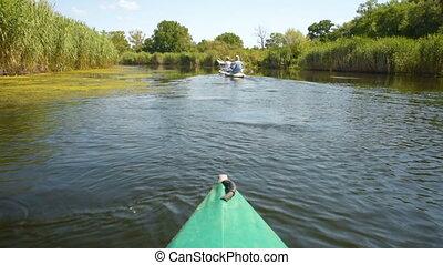 canoe floats on calm river in summer green forest - Canoe ...