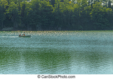 Canoe in a blue lake