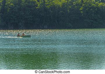 Canoe in a blue lake