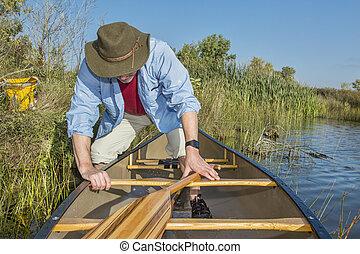 canoe launching on a lake