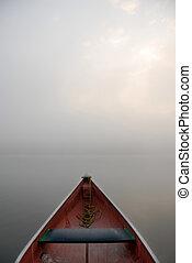 misty morning with canoe