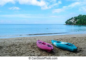 Canoe moored on the Kamala beach in Phuket Thailand.