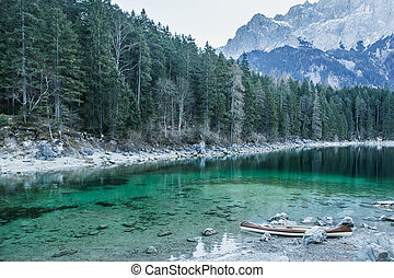 Canoe on calm blue lake, Aibsee, Germany