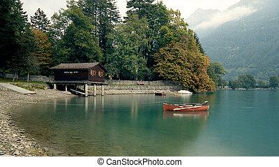Canoe on lake in Swiss Alps