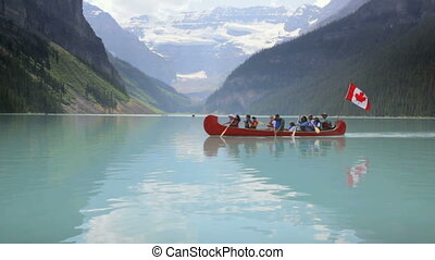 Group canoeing on Lake Louise, Banff National Park, Canada