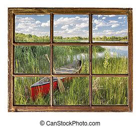 canoe on lake shore - window view