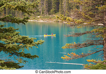 Canoe on Moraine Lake - View on a couple rowing their canoe...