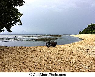 Canoe on the beach in Kiriwina, Papua New Guinea.