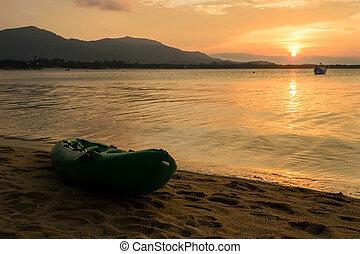 Canoe on the beach with Sunset on Koh Samui in Thailand