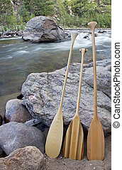 canoe paddles and river
