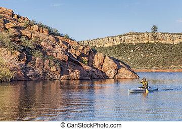 canoe paddling on a lake