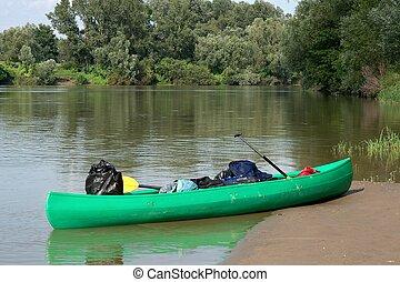 Canoe parked on the riverside