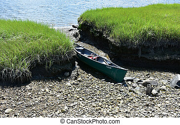 Canoe Pulled Up on a Rocky Shore Along a River