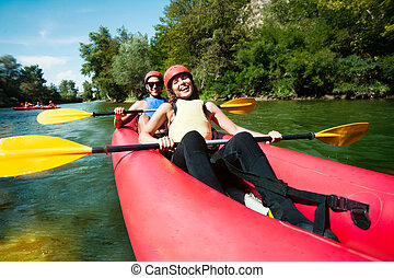 Canoe rafting team of two