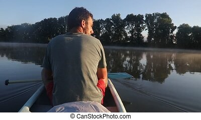 Canoe tour on a river - Canoeing in early morning mist, soft...