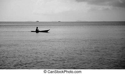 Canoe with man in Ocean BW - Canoe with man in Ocean Black...
