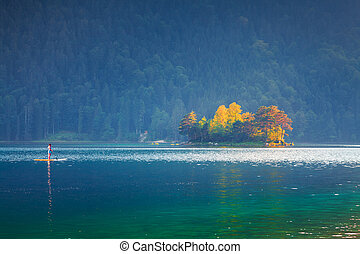 Canoeing at summer morning on the Eibsee lake.